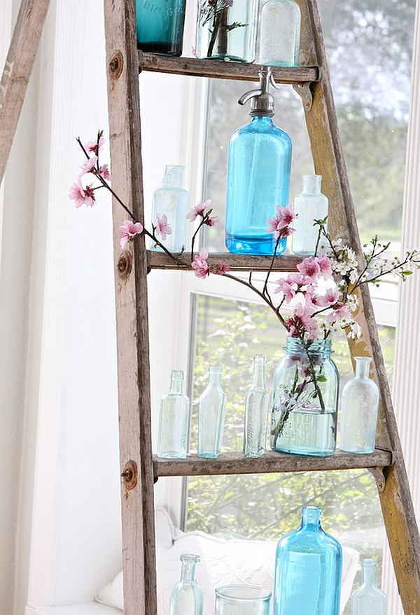 Hint-of-nature-vintage-bottles-and-a-rustic-ladder-create-a-unique-DIY-display
